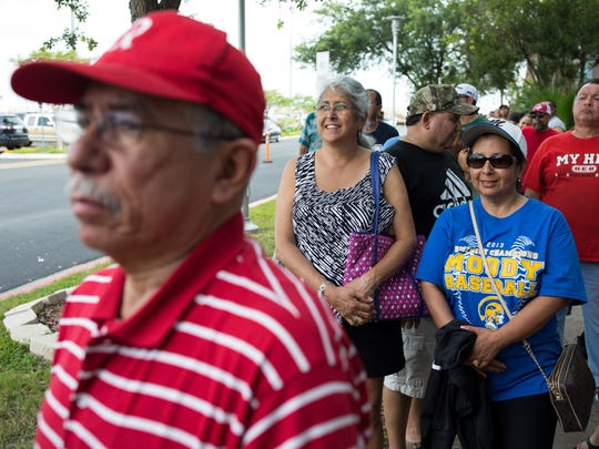 Fans Wednesday wait inline outside Whataburger Field to buy tickets for Ray and Moody High School's play off games Thursday and Friday at Whataburger Field.