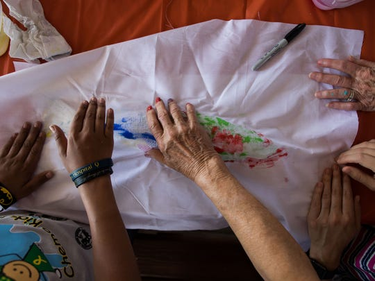 Paint and fabric are used to make prints of fish during Driscoll Children's Hospital's 25th annual Chemo Kids Fish Off in Aransas Pass on Tuesday, June 6, 2017