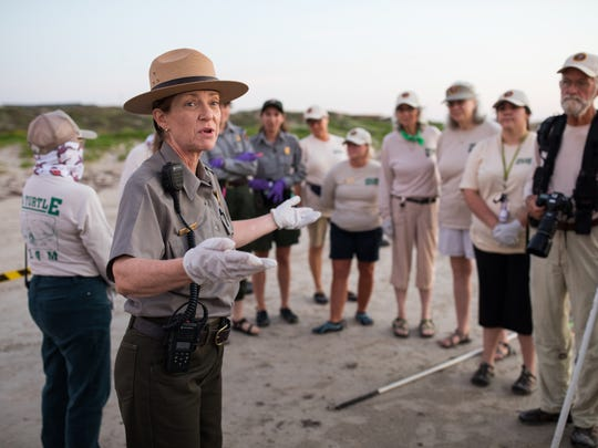 Donna Shaver, chief of the Division of Sea Turtle Science and Recovery at Padre Island National Seashore, talks to volunteers before the first public release of Kemp's ridley sea turtle hatchlings Wednesday, June 7, 2017, at the seashore.
