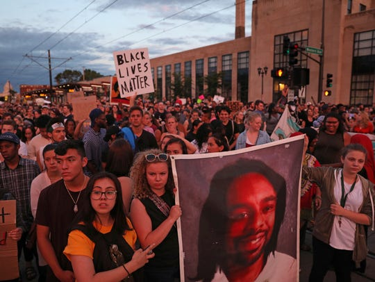 Supporters of Philando Castile are pictured holding