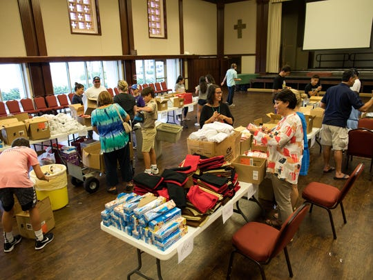 Volunteers help staff create 750 care bags for Mission