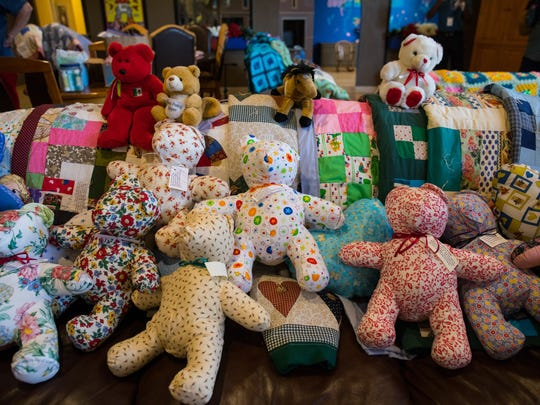 Teddy bears donated to the Ronald McDonald House Charities of Corpus Christi by the Order of the Eastern Star sit on a couch on Wednesday, July 12, 2017.