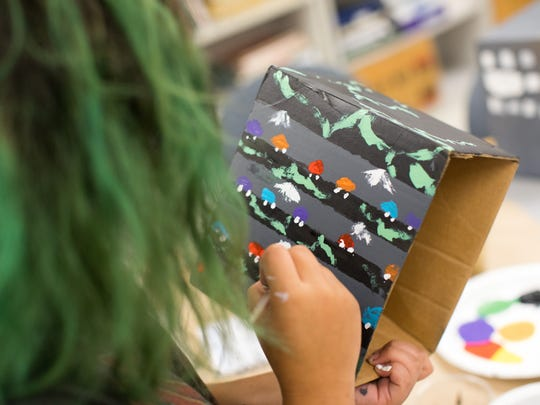 Raelynn Robriguez paints an obstacle for her robot during the Women in Technology camp's session titled Unmanned Ground Vehicles on Thursday, July 20, 2017, at the Conrad Blucher Institute.