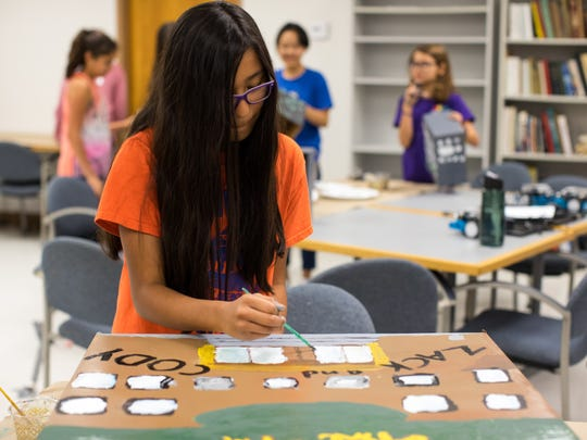 Raelynn Robriguez paints an obstacle course for her robot during the Women in Technology camp's session titled Unmanned Ground Vehicles on Thursday, July 20, 2017, at the Conrad Blucher Institute.