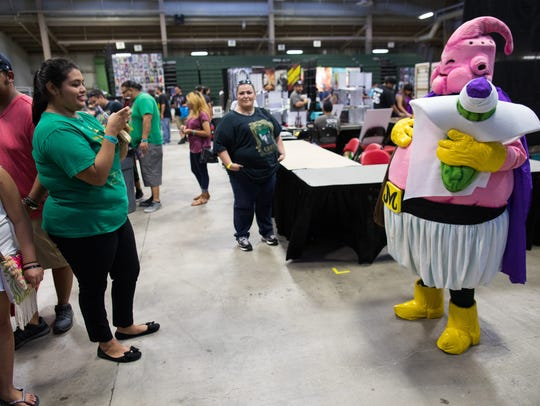 A cosplayer dressed as Good Buu poses for a photo during