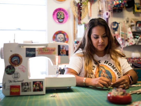 Elena Flores founder of Sew Bonita works to make a