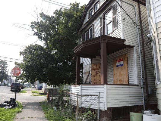 Photos of homes in Paterson where the city has made efforts to find buyers.