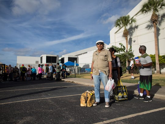 Residents wait outside the Corpus Christi Natatorium