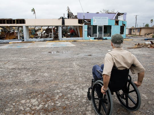 Texas Gov. Greg Abbott looks over a damaged stores in  Rockport during a tour on Monday, Aug. 28, 2017 two days after Hurricane Harvey hit the town.