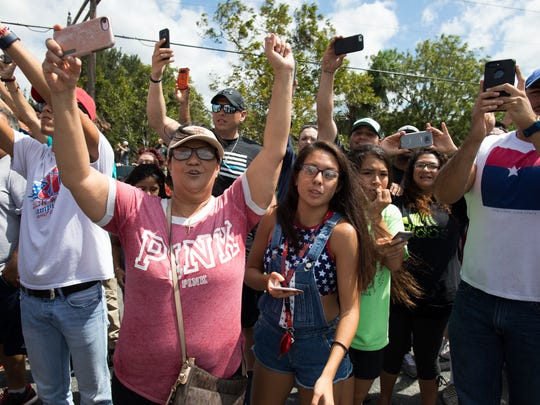 Spectators cheer and waive as President Donald Trump's motorcade arrives at Annaville fire station one on Leopard Street on Tuesday, Aug. 29, 2017.