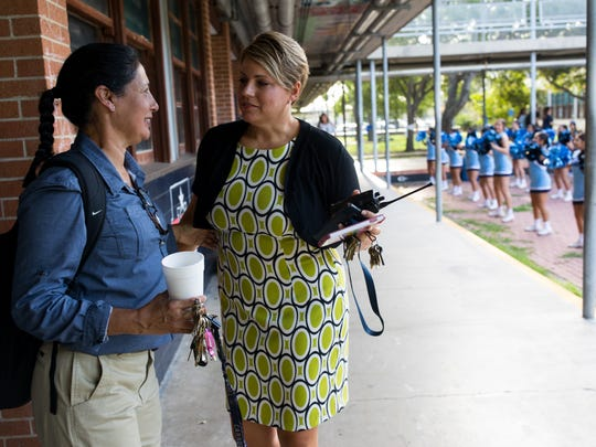 Carroll High Principal Kelly Manlove talks with Leticia