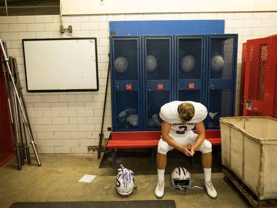 Aransas Pass Banya Owen along with his teammates wait in the visiting teams locker room for their game against Taft at Akins Wildcat Stadium in Portland on Friday, Sept. 15, 2017.