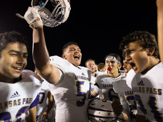 Aransas Pass celebrates after defeating Taft 28-24