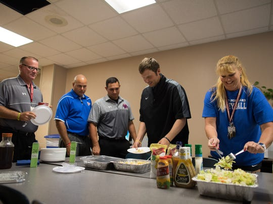 The Gregory-Portland High School staff eat a lunch donated to them as part of operation feed staff on Thursday, Sept. 21, 2017.