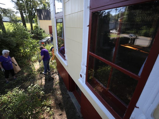 Volunteers cleaning up the Captain William Tyson House