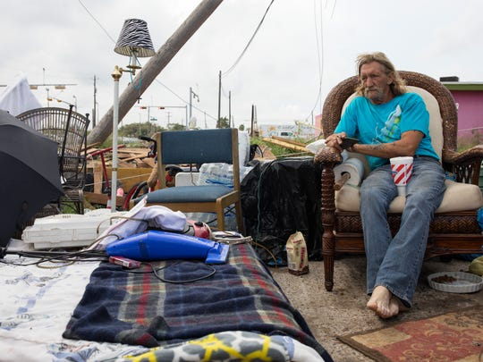 Dirk Hout sits outside his apartment with his belongings in Aransas Pass on Sept. 21.  He and his girlfriend, Therma Followell, were driven out of their apartment by the mold, post-Hurricane Harvey.