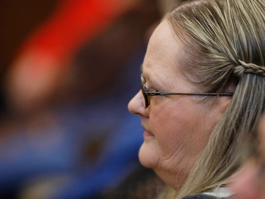 Lisa Chambers, mother of 19-year-old Jessica Chambers, who was burned to death almost three years ago, listens to closing arguments during the capital murder trial of Quinton Tellis, 29, charged with her death, Sunday, Oct. 15, 2017, in Batesville, Miss.