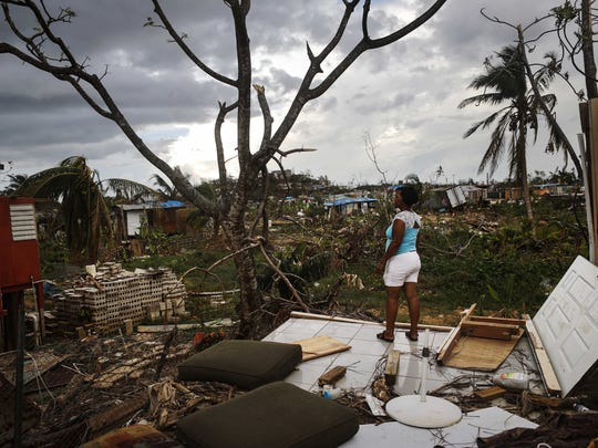 San Isidro, Puerto Rico resident Mirian Medina stands on her property on Oct. 5, 2017, about two weeks after Hurricane Maria swept through the island. Residents in her section of the town remain without grid power or running water.