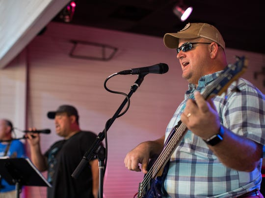 Kirby Warnke plays bass with Hard At Play at Brewster Street on Saturday, Oct. 14, 2017. All the bandmembers work for Corpus Christi Independent School District. Warnke is chief of CCISD Police Department.