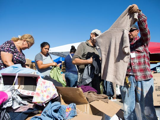 Residents look through donations at the Aransas County