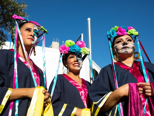 Folklorico dancers watch others perform during the 10th annual Dia de los Muertos Street festival in downtown Corpus Christi on Saturday, Oct. 28, 2017.