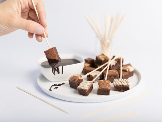 Dipping brownie squares in chocolate is a great way
