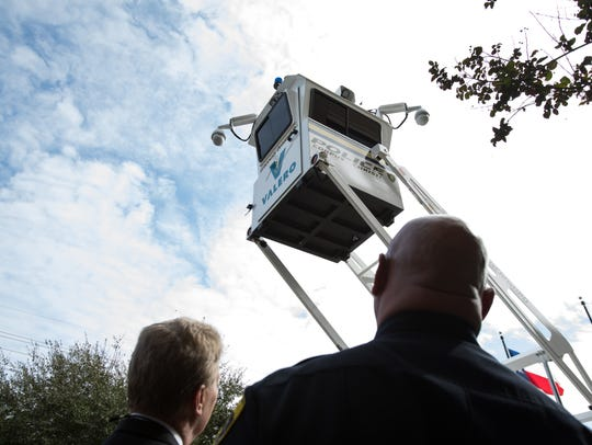 Corpus Christi Police Chief Mike Markle looks up at