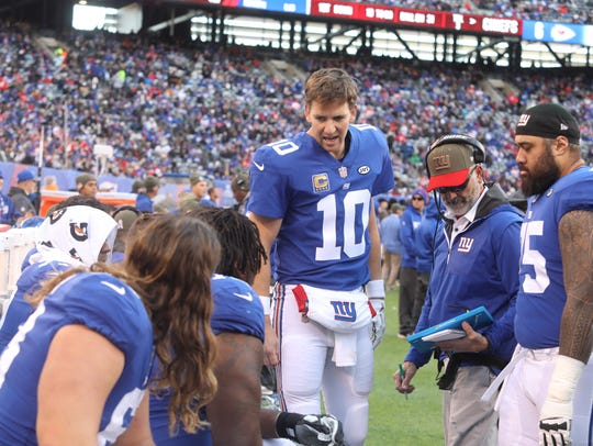 New York Giants quarterback Eli Manning talks to his