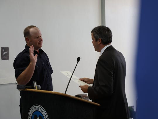 Hattiesburg firefighter Brett Flatt is sworn in Monday