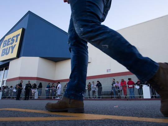 People wait online at Best Buy on Thanksgiving for the store to open at 5pm on Thursday, Nov. 23, 2017.