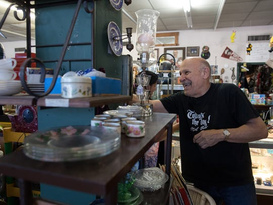 Bumblebee Antiques owner Jerry Liedeker shows a customer