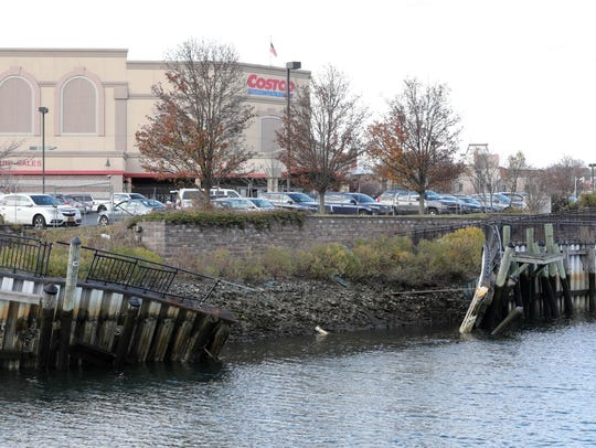 The dilapidated bulkhead and promenade along the Byram River adjacent to the parking lot at Costco.