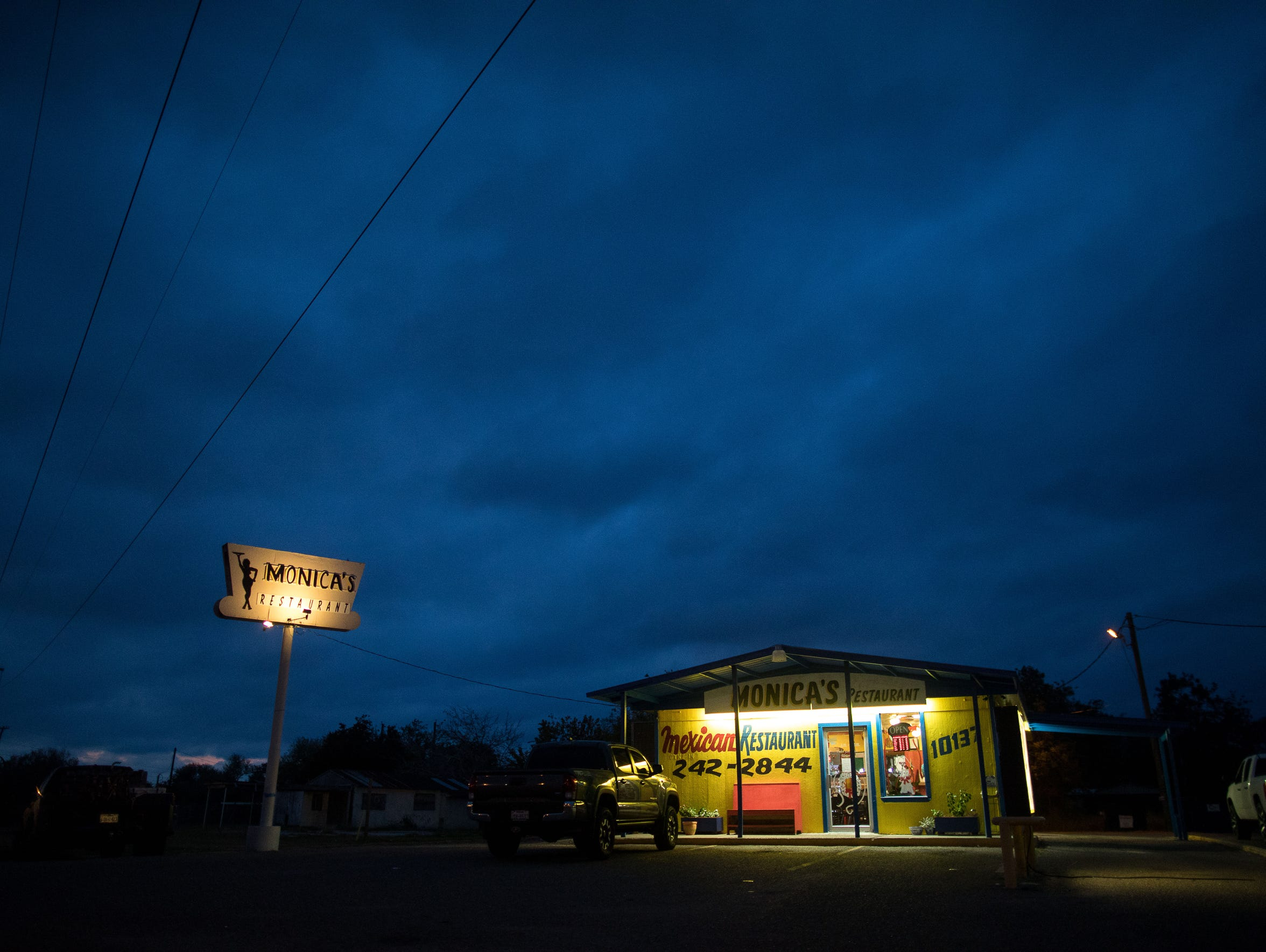 A truck is parked outside of Monica's Restaurant at 7:30am as the sun starts to rise along Leopard Street in Corpus Christi on Nov. 11, 2017. Monica's Restaurant is owned by Monica Rocha Alcarez, a DACA recipient. Monica who was an undocumented immigrant who was brought over from Mexico at the age of four.