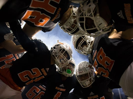 Refugio huddles before talking the field for the Class 2A D-I State Semifinal against San Augustine at Cy Fair FCU Stadium in Cypress, Texas on Thursday, Dec. 14, 2017.