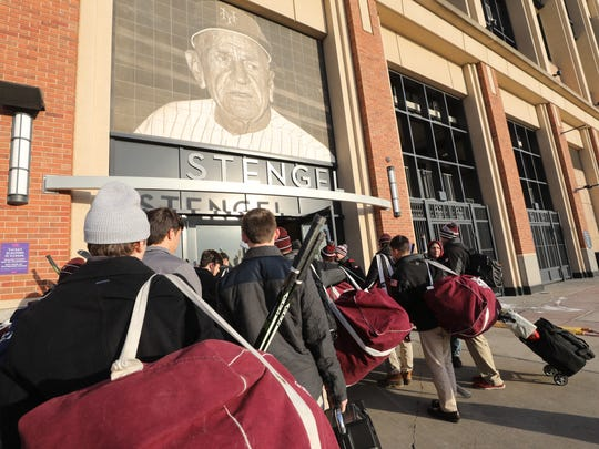 The Don Bosco hockey team enters the Casey Stengel Gate at Citi Field for their game against the Hun School.