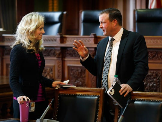 Iowa Senate Minority Leader Janet Petersen, left, talks with then-Senate Majority Leader Bill Dix during a legislative forum last January.