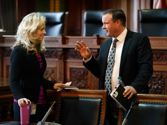 Iowa Senate Minority Leader Janet Petersen, left, talks
