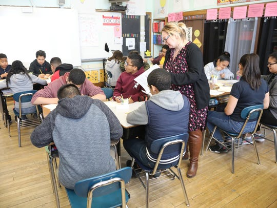 Rosa Kopic leads a class at School 18 in Paterson. Paterson's schools are 67 percent Hispanic and 22 percent are black. Wayne, which borders Paterson to the west, is 11 percent Hispanic and 1 percent black.