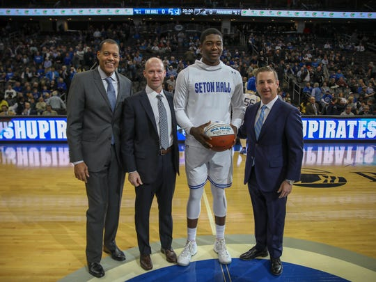 Angel Delgado receives a commemorative ball for becoming the Big East's all-time leading rebounder prior to Wednesday's game against Providence.