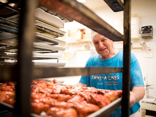 Wed., Feb. 14, 2018: Clem Schmidt, owner of Schmidt's Bakery in Batesville, Indiana, and maker of the cherry thing-a-lings, lets the just-glazed cherry fritters cool. Schmidt has been making thing-a-lings for 43 years, but attributes their rocketing success to an article Polly did in 2011. When Polly wrote about them, they had one day of thing-a-lings. Now they have four. The Enquirer/Carrie Cochran