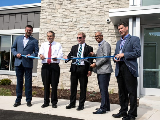 From left: Rich Otradovec, RODAC president and CEO; Bob Ziegelbauer, Manitowoc County executive; Manitowoc Mayor Justin Nickels; Dr. Ashok Rai, Prevea Health president and CEO; and Brian Charlier, Prevea Health senior vice president cut a ribbon to celebrate the opening of the Prevea Manitowoc Health Center in October 2018.