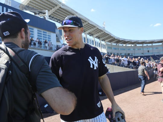Aaron Judge is greeted as he comes out onto the field for the team workout this afternoon.