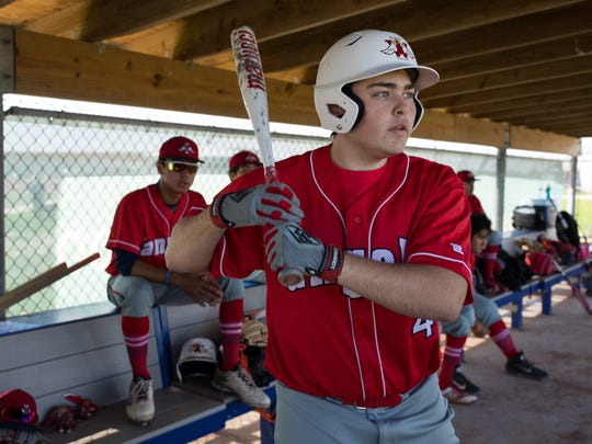 Incarnate Word Academy's Robert Walsh waits to bat in the dugout during a game at Veterans Memorial High School on Thursday, March 1, 2018.