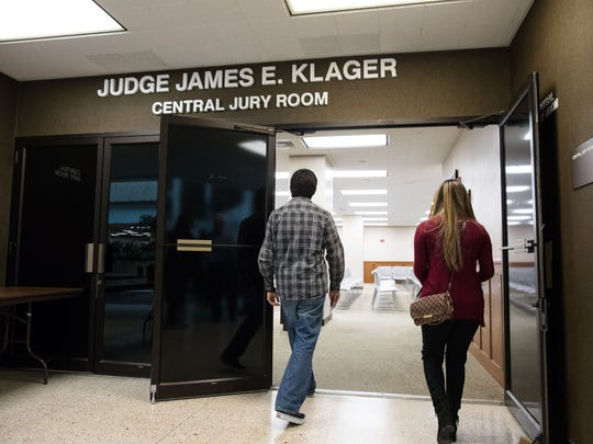 People enter the Central Jury room in the Nueces County Courthouse.