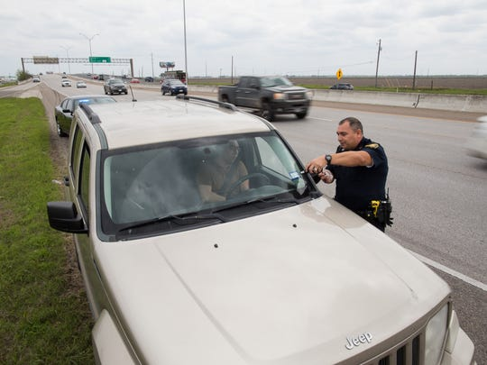 Corpus Christi police Senior Officer Gilbert Casas in the departments new stealth pulls over a car along South Padre Island Drive for using their cellphone on Thursday, March 8, 2018.