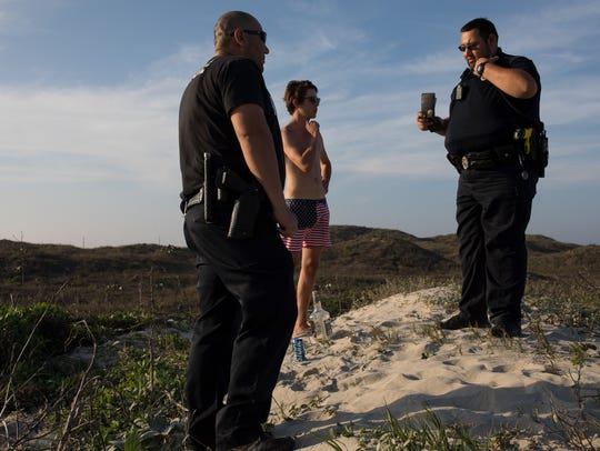 Police officers Joseph Rivas and Gabriel Lopez talk