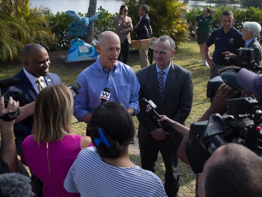 Gov. Rick Scott, alongside Visit Florida's president
