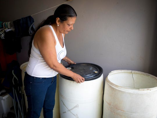 "Magdaliz Medina has been without electricity and running water since Hurricane Irma. ""I sit and cry all day,"" Medina, 42, said as tears welled in her eyes. ""I was depressed before the storm. Maria made it worse."""