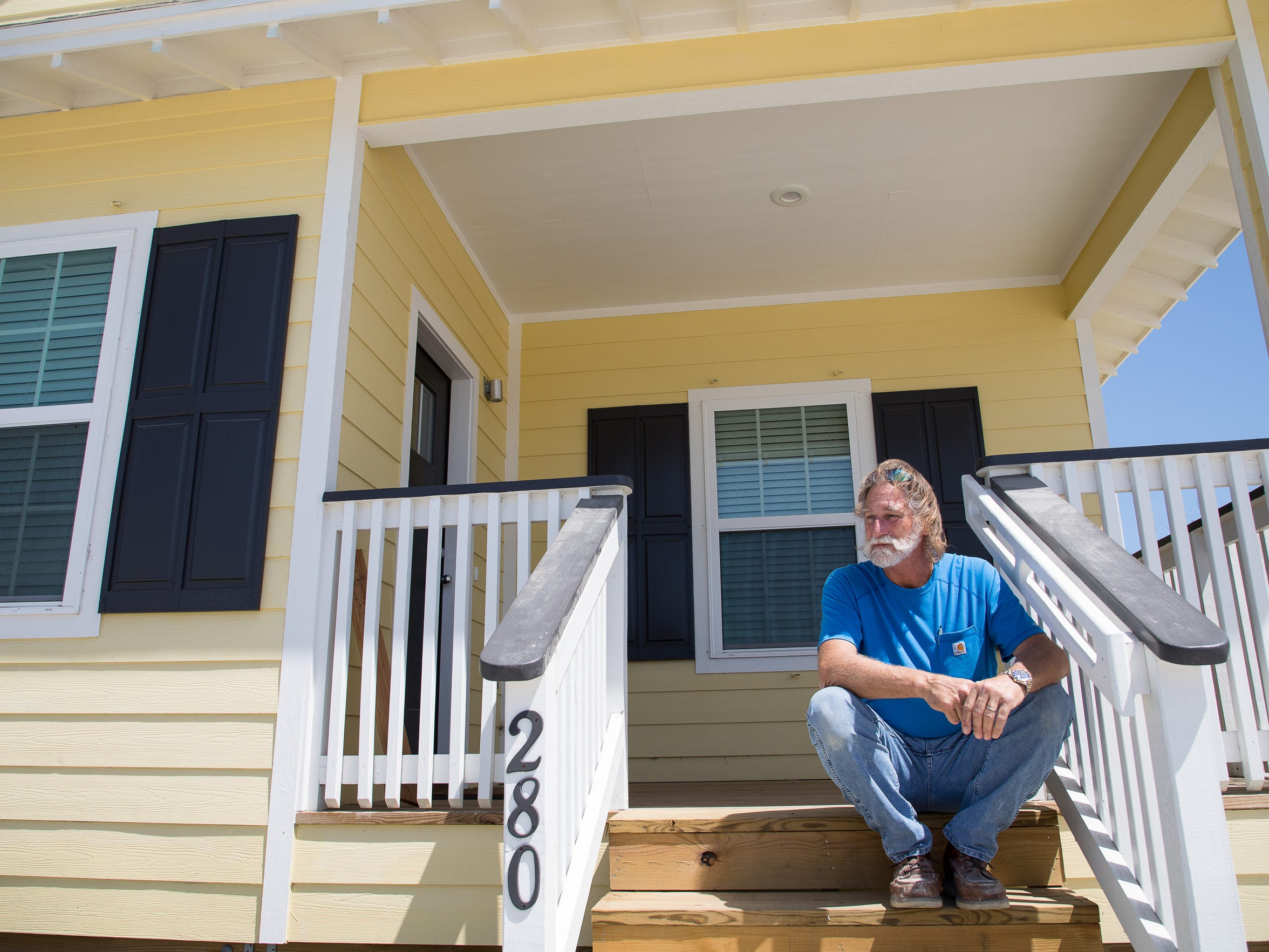 Developer Bill Gavit sits on the porch of a home he built under Port Aransas' flexible unit development ordinance. The ordinance allows construction of residential development anywhere in the city, so long as the property is restricted to long-term use. In return, developers are offered concessions. The ordinance is part of the City Council's attempts to facility housing that is affordable for middle-class and service industry workers.