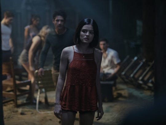 "Lucy Hale (center) finds herself and her friends playing a dangerous game in ""Blumhouse's Truth or Dare."""